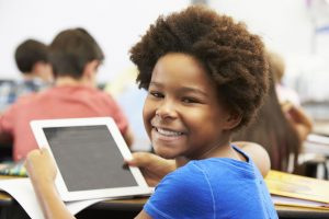 young African boy enjoying educational games on a smartphone