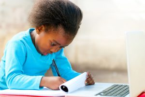 A young Kenyan girl learning- edutainment