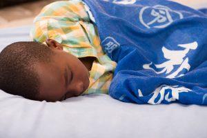 A young boy sound asleep